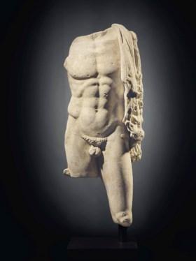 A ROMAN MARBLE TORSO OF HERCULES