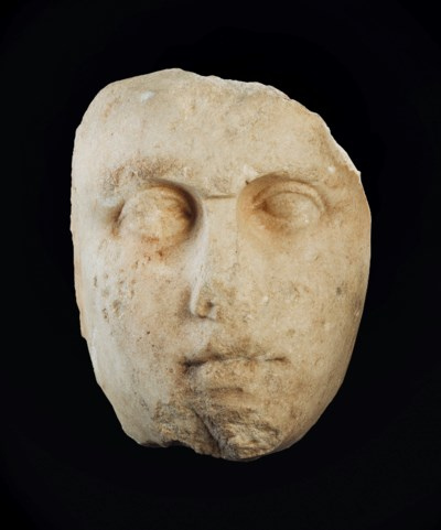 AN OVER-LIFESIZED GREEK MARBLE