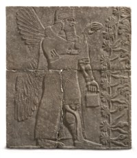 AN ASSYRIAN GYPSUM RELIEF OF A