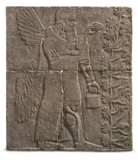 AN ASSYRIAN GYPSUM RELIEF OF A WINGED GENIUS