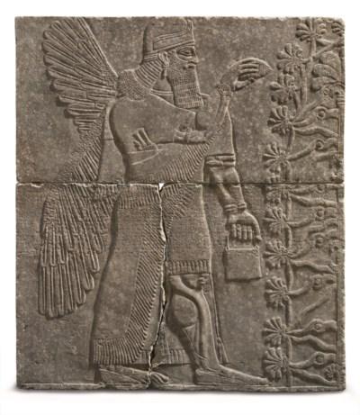 AN ASSYRIAN GYPSUM RELIEF OF A