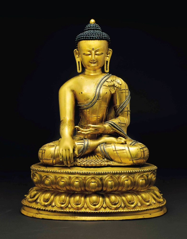 A large and important silver-inlaid gilt bronze figure of Buddha Shakyamuni, Tibet, circa 1400. Buddha 16⅛  in. (40.8  cm.) high; 20¾  in. (52.7  cm.) high with base. Sold for $3,612,500 on 21 March 2018 at Christie's in New York