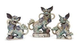THREE CHINESE EARTHENWARE BUDDHIST LIONS