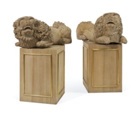 A PAIR OF CHINESE WOOD MODELS OF BUDDHIST LIONS