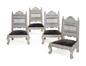 A SET OF FOUR INDIAN BRASS-MOUNTED AND SILVERED-METAL LOW CH
