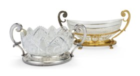 A LATVIAN SILVER MOUNTED CUT-GLASS CENTERBOWL, AND A GILT-ME