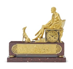 A FRENCH ORMOLU AND ROUGE GRIOTTE MARBLE FIGURAL MANTEL CLOCK
