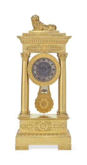 A CHARLES X ORMOLU PORTICO CLOCK