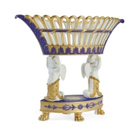 A PARIS PORCELAIN BLUE AND GOLD GROUND RETICULATED FIGURAL B
