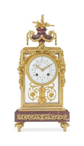 A NAPOLEON III ORMOLU AND ROUGE GRIOTTE MARBLE MANTEL CLOCK