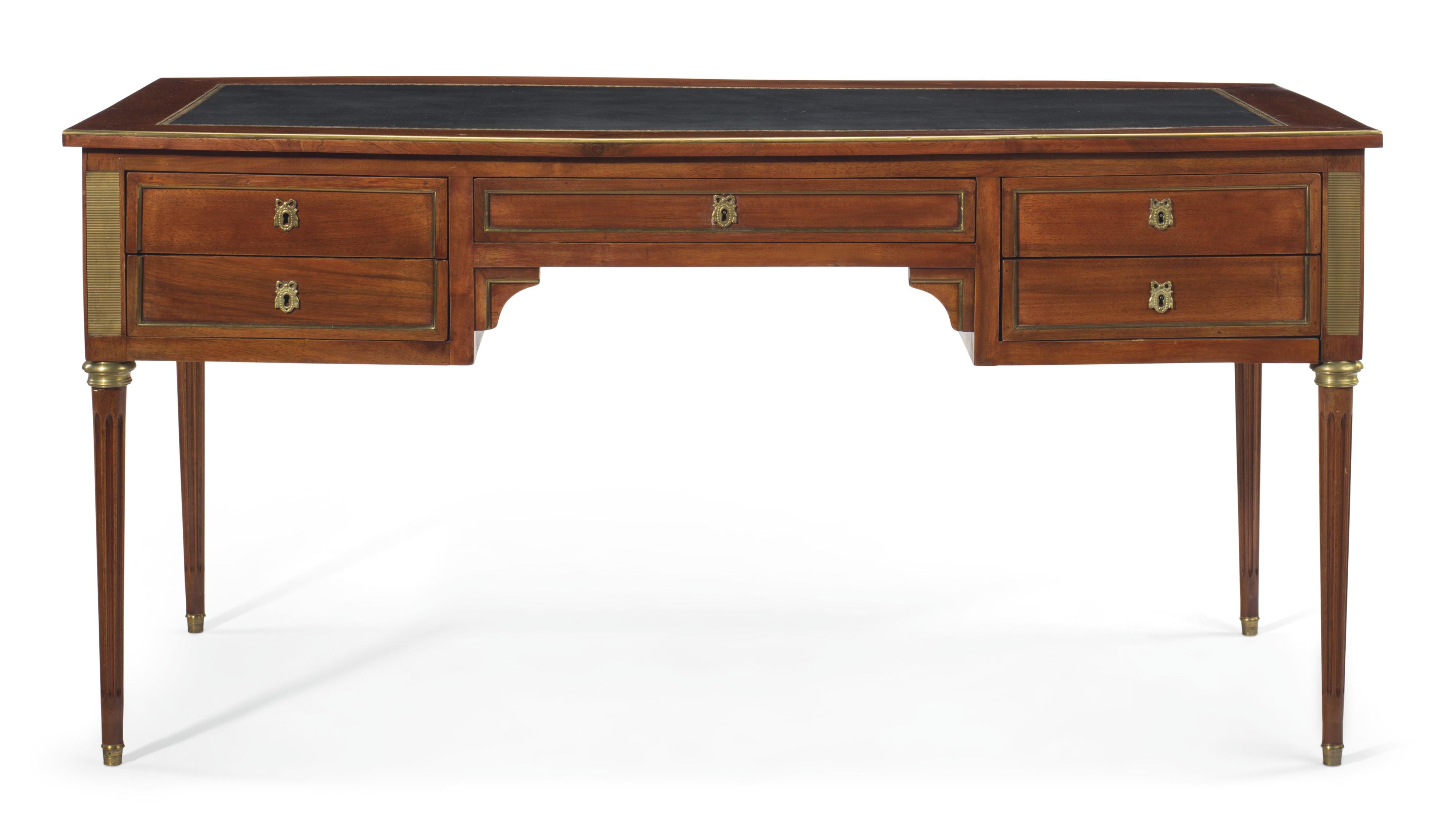 A french ormolu mounted mahogany bureau plat by maison jansen