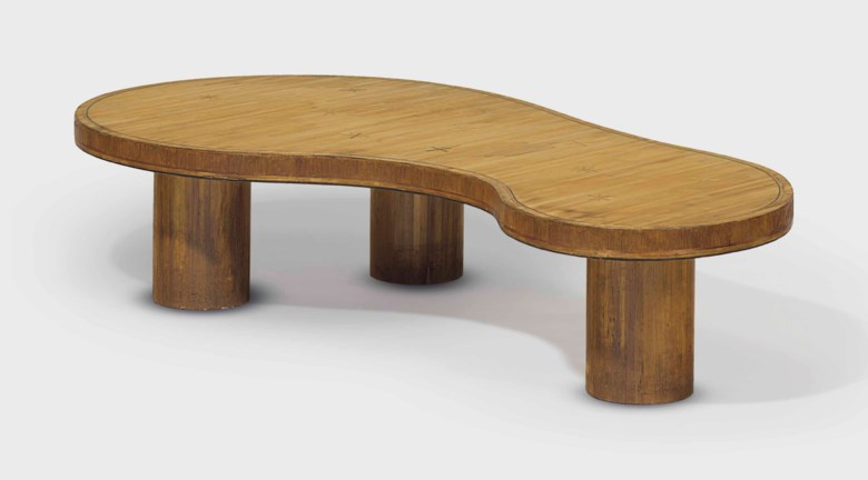 Jean Royère (1902-1981), a Flaque low table, circa 1954. 10  in (25.4  cm) high; 49½  in (125.8  cm) wide; 25¾  in (63.5  cm) deep. Estimate $100,000-150,000. Offered in Design on 20 June 2018 at Christie's in New York
