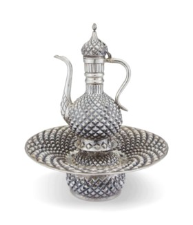 A MIDDLE EASTERN SILVER EWER, BASIN AND FILTER