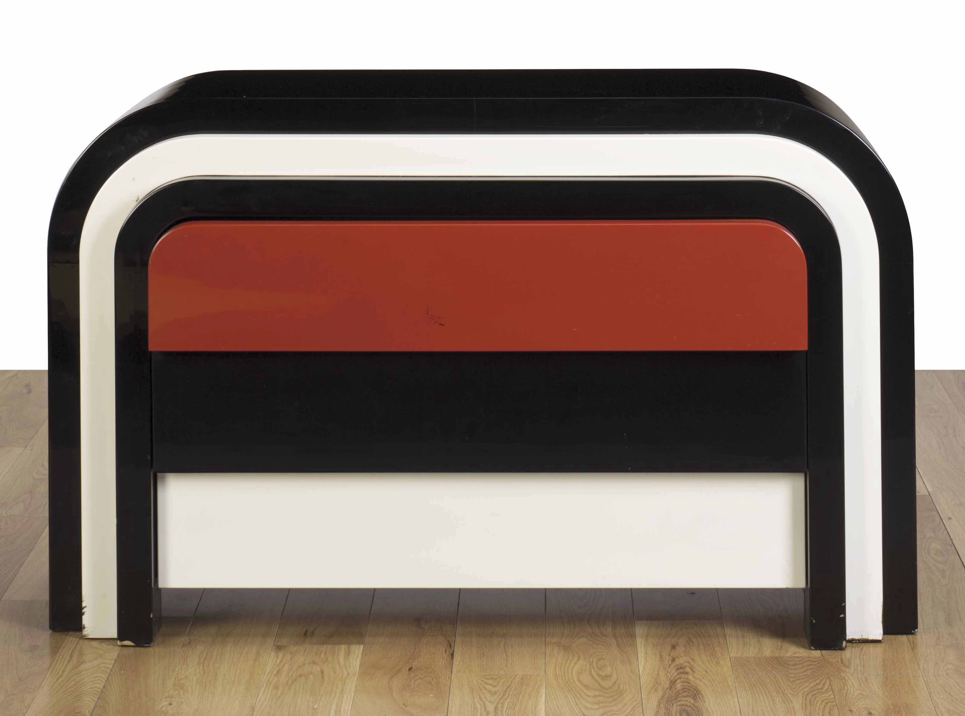 A BLACK, RED AND WHITE LACQUERED THREE-DRAWER COMMODE