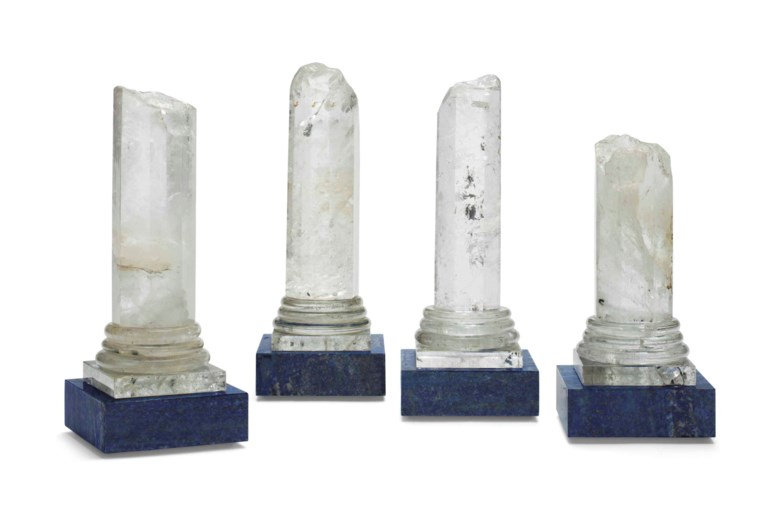 A set of four rock crystal and lapis lazuli columns. 12  in (30.5  cm) high, the tallest. Estimate $1,500-2,500. Offered in Interiors New York Visions on 6 June at Christie's in New York