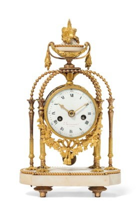 A LATE LOUIS XVI ORMOLU AND WHITE MARBLE MANTEL CLOCK