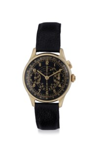 Tissot. A Fine 14k Gold Chronograph Wristwatch with Black Dial
