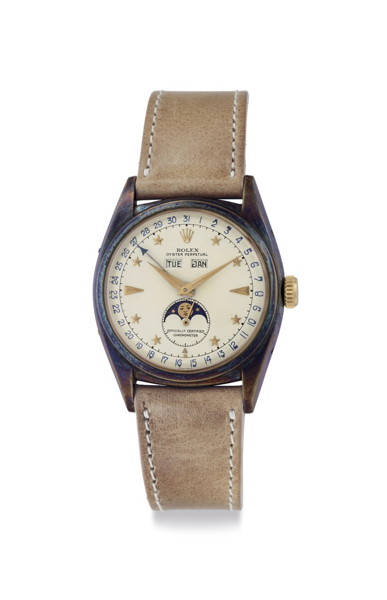 Rolex. An extremely fine, rare and attractive 18k gold automatic triple calendar wristwatch with star dial and moon phases, circa 1952. Signed Rolex, Oyster Perpetual, officially certified chronometer, ref. 6062, case no. 916321. Price realised $1,572,500 on 6 December 2018 at Christie's in New York