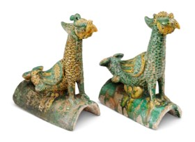A PAIR OF GREEN AND AMBER-GLAZED PHOENIX-FORM ROOF TILES