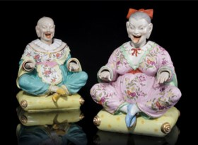A PAIR OF CONTINENTAL PORCELAIN PAGODA FIGURES
