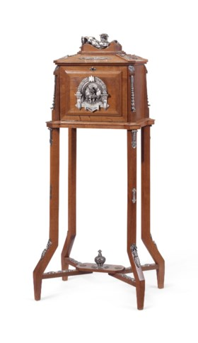 A NAPOLEON III SILVERED COPPER-MOUNTED OAK CIGAR CABINET-ON-