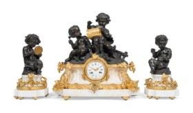 A FRENCH ORMOLU, PATINATED-BRONZE AND WHITE MARBLE THREE-PIE