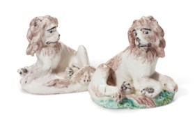 A PAIR OF DERBY PORCELAIN MODELS OF RECUMBENT LIONS