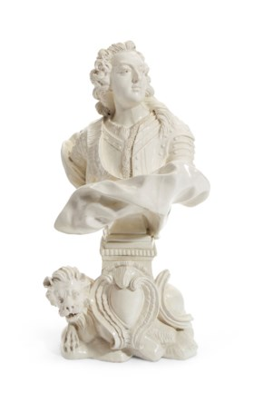 A FRENCH FAIENCE PORTRAIT BUST OF LOUIS XV