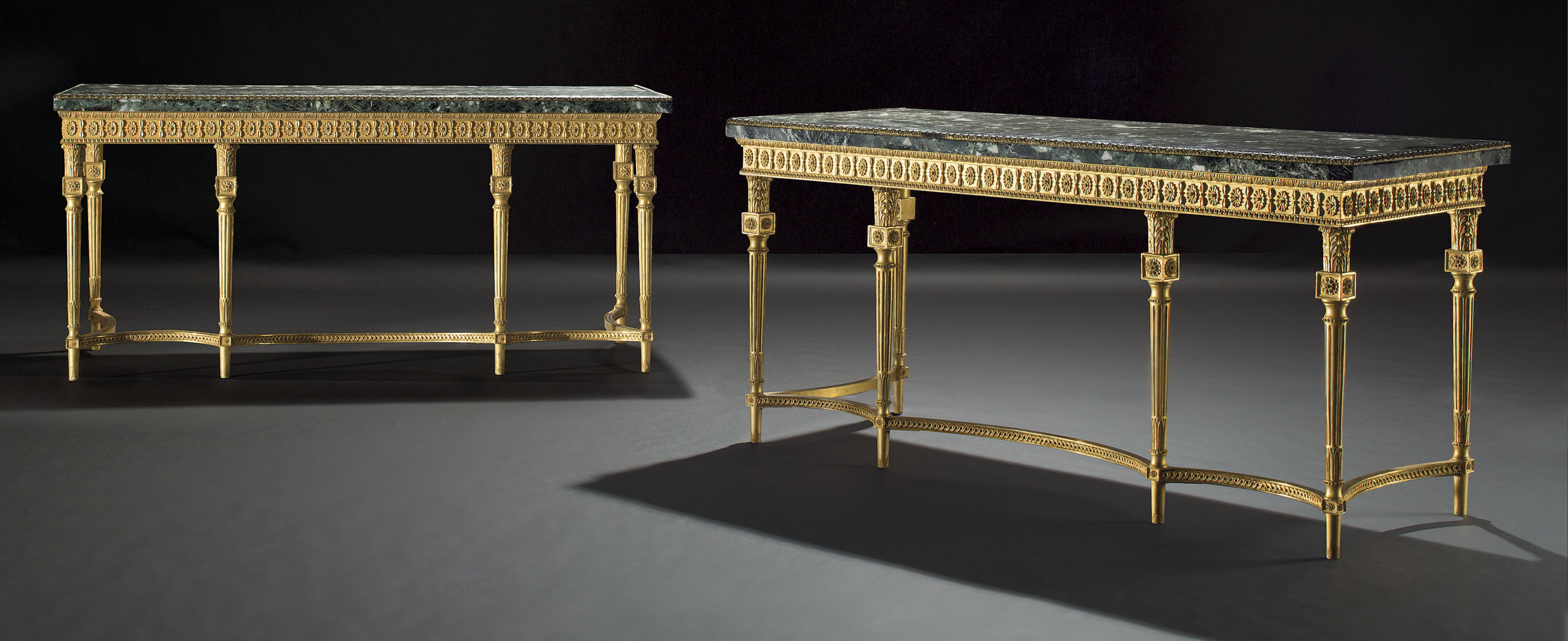 A PAIR OF GEORGE III GILTWOOD SIDE TABLES