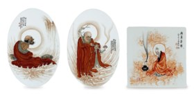 THREE IRON-RED AND GRISAILLE-DECORATED PORCELAIN PLAQUES