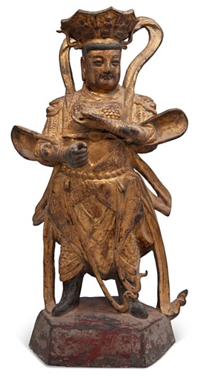 A GILT-BRONZE FIGURE OF A GUARDIAN KING