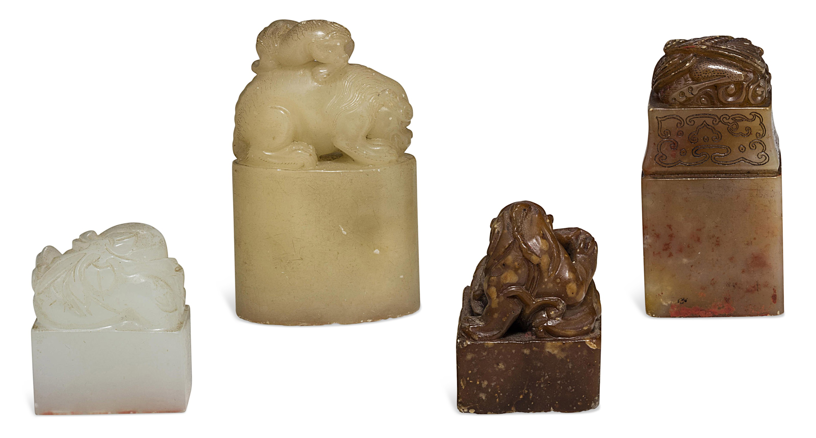 A WHITE JADE SEAL AND THREE SOAPSTONE SEALS