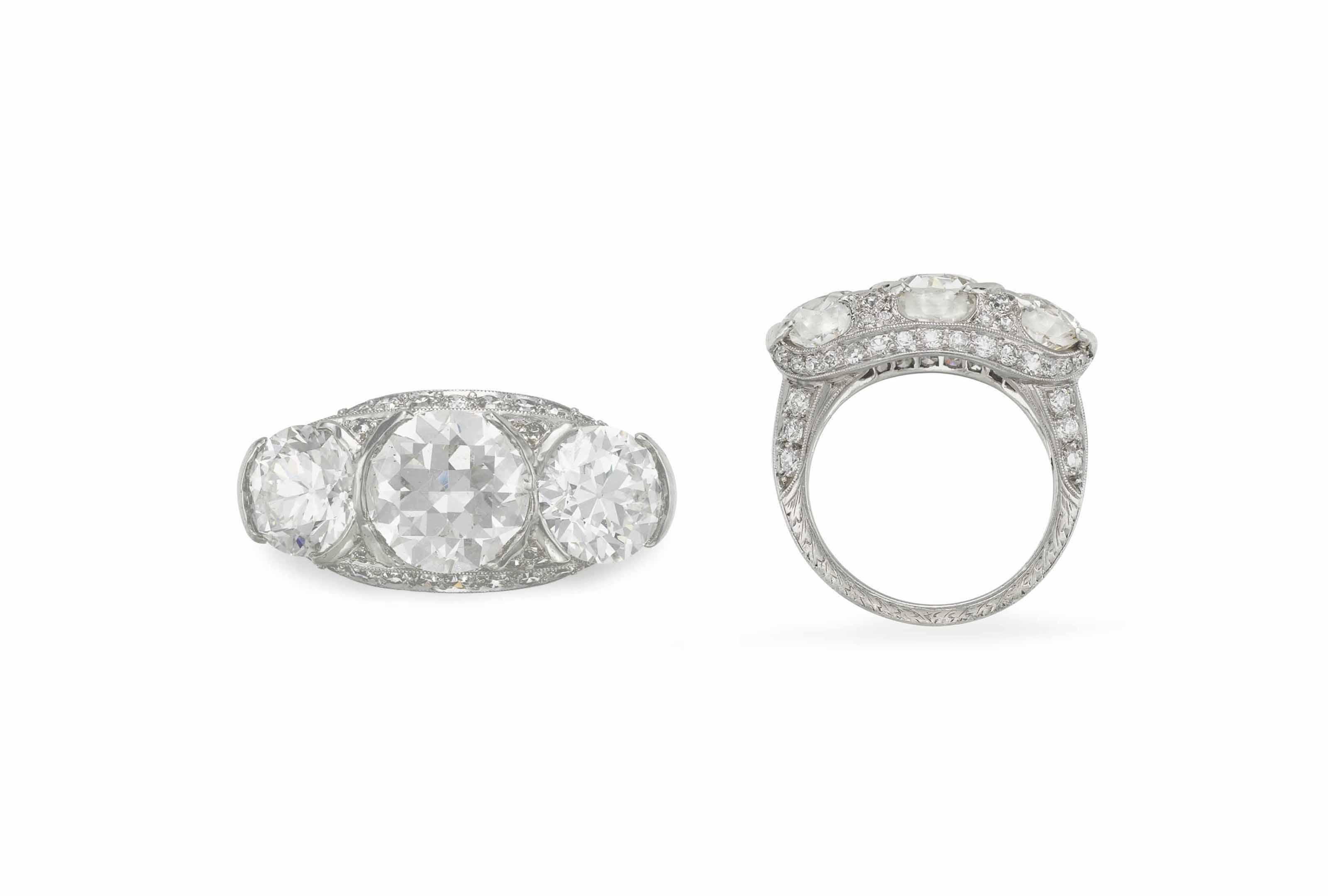 AN ART DECO THREE-STONE DIAMOND RING, BY J. E. CALDWELL & CO.