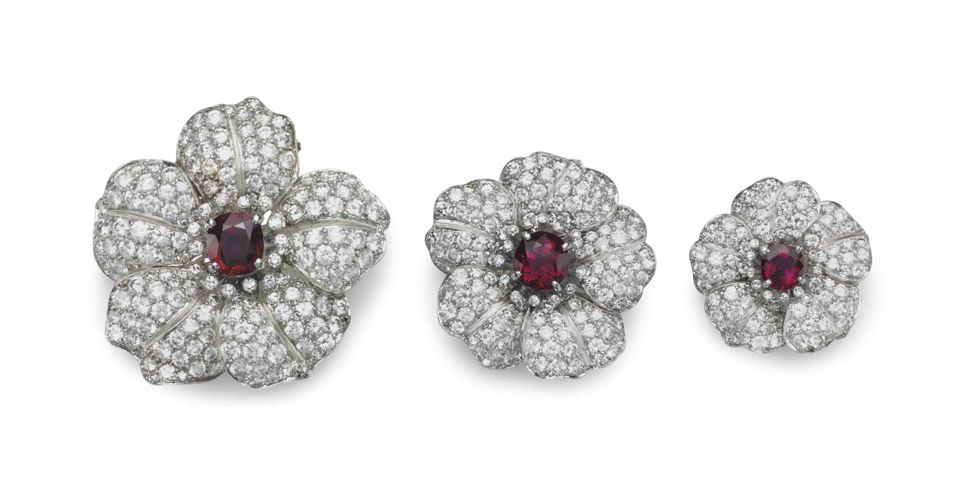 A SET OF THREE RUBY AND DIAMOND FLOWER CLIP BROOCHES, BY RAYMOND YARD