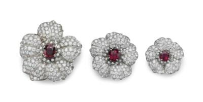 A SET OF THREE RUBY AND DIAMON