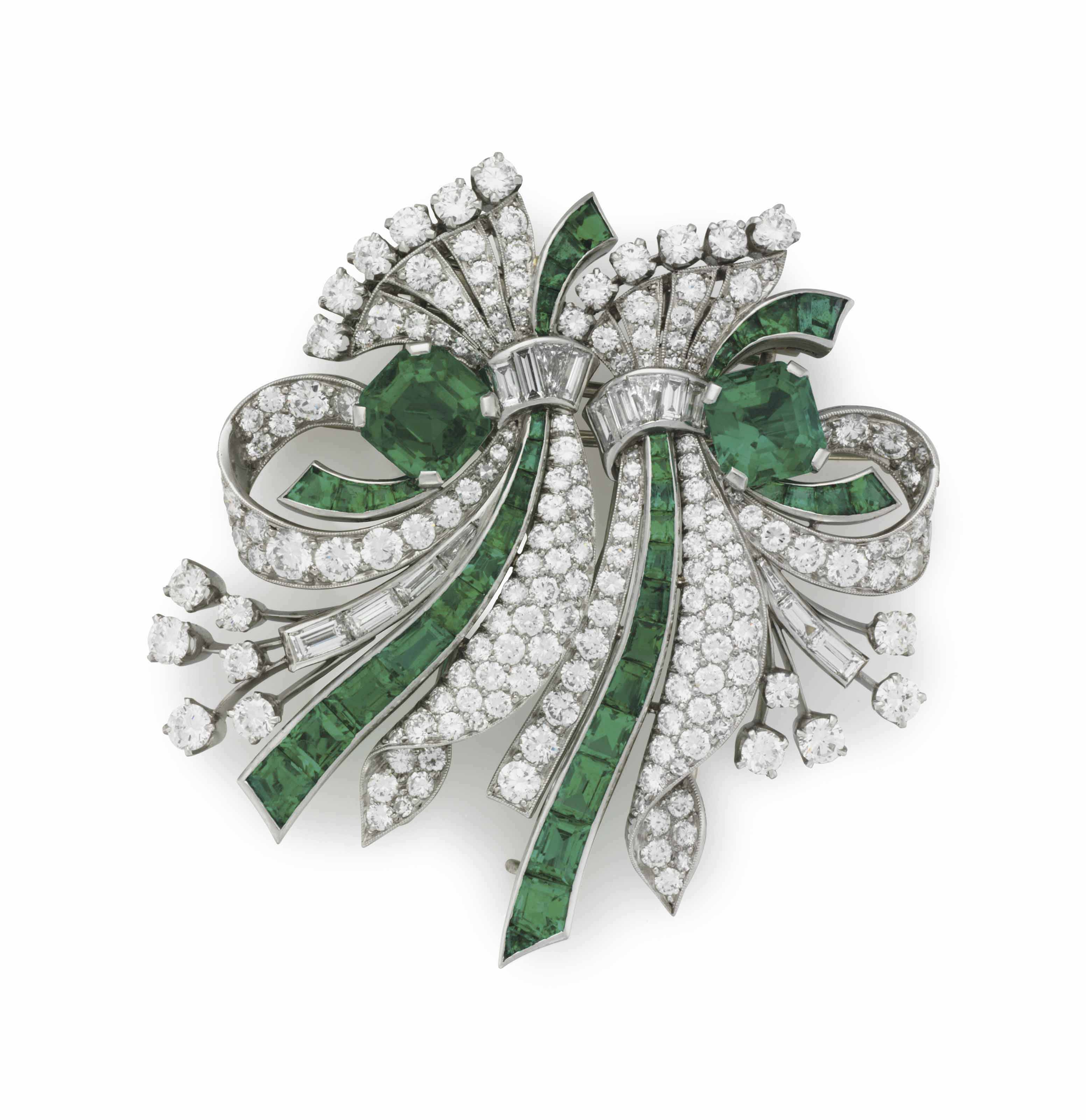 AN EMERALD AND DIAMOND DOUBLE-CLIP BROOCH, BY RAYMOND YARD