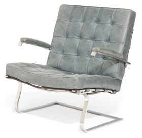 AN AMERICAN STEEL AND LEATHER ARMCHAIR