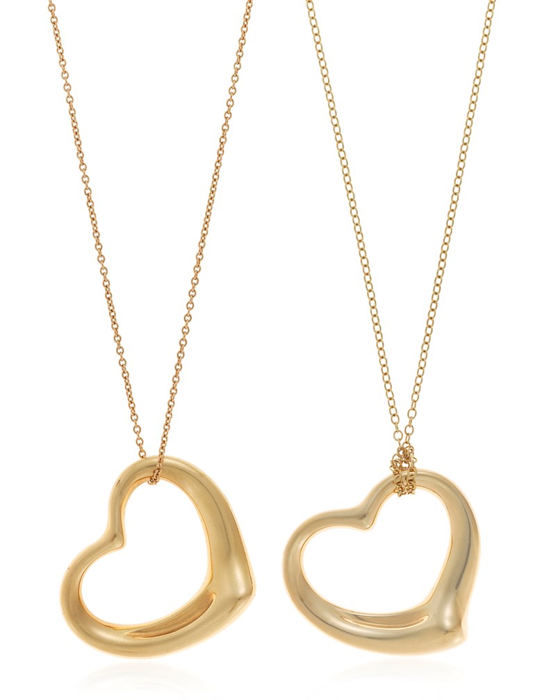 Two Tiffany & Co. Elsa Peretti open heart necklaces. Pendants 2.7 x 2.3 cm and 3.5 x 3.2 cm. Chains 40.5 cm and 72.5 cm. Sold for $1,875 on 4 October 2018 at Christie's