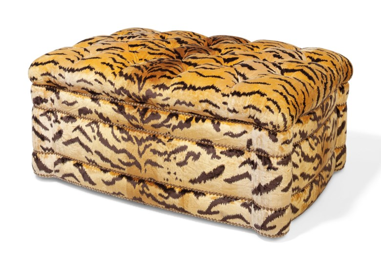 A tiger-print upholstered button-tufted ottoman. 18½  in (47  cm) high, 39½  in (100  cm) wide, 27¼  in (69  cm) deep. Estimate $1,000-1,500. This lot is offered in Interiors on 11 December 2018 at Christie's in New York