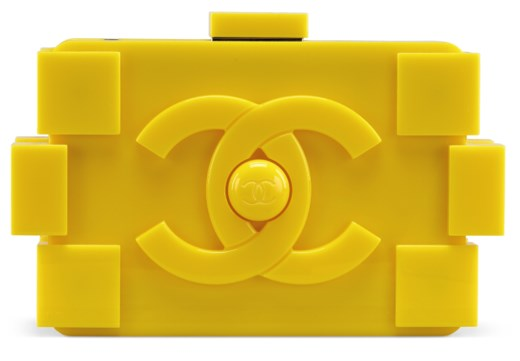 A YELLOW LUCITE LEGO CLUTCH WITH SILVER HARDWARE