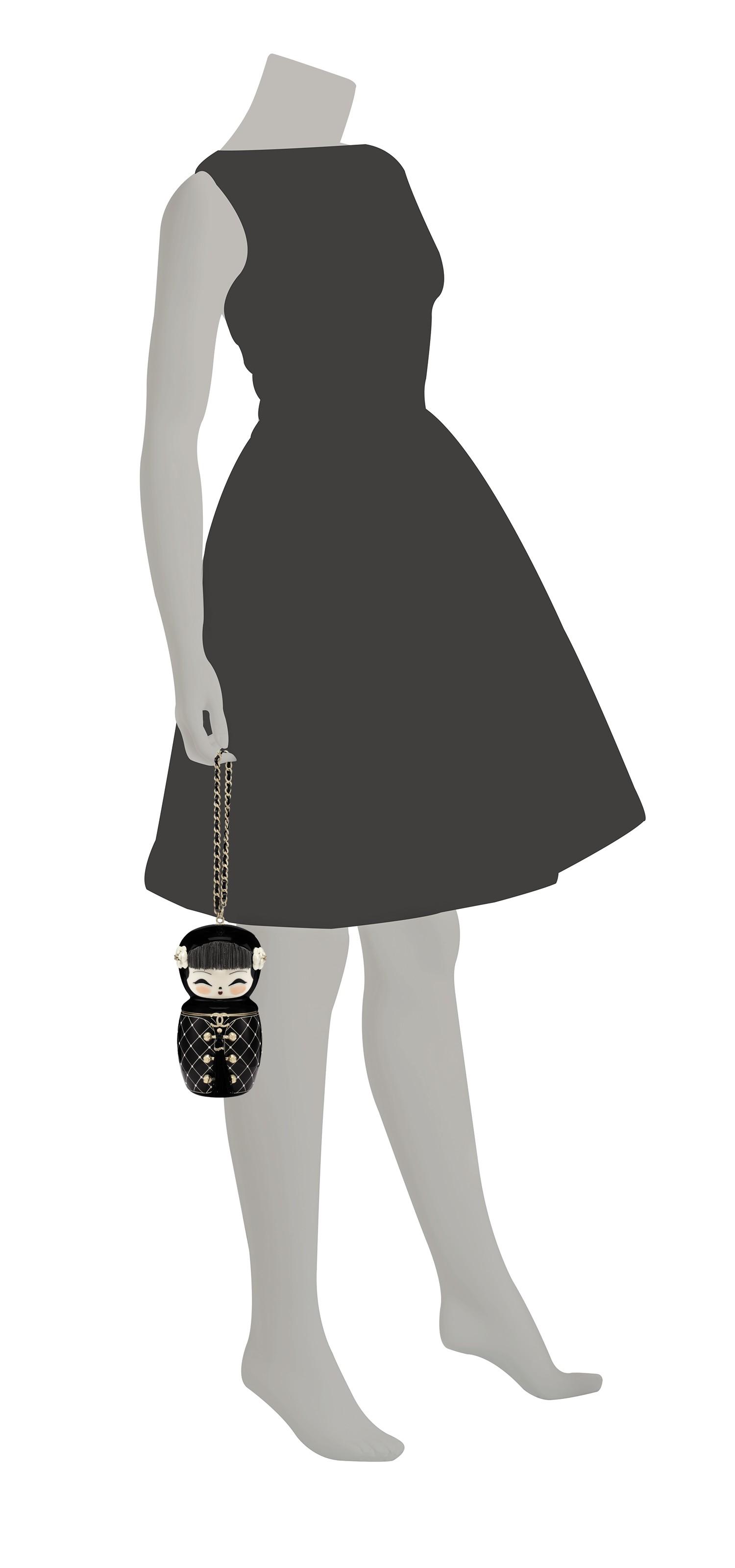 A MÉTIERS D'ART PARIS-SHANGHAI BLACK LUCITE MATRYOSHKA EVENING BAG WITH GOLD HARDWARE