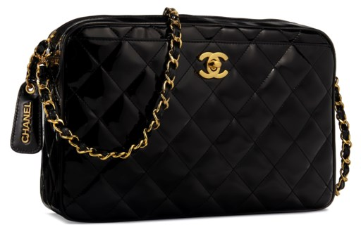 A Black Patent Leather Camera Bag With Gold Chanel