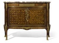 A FRENCH ORMOLU-MOUNTED MAHOGANY, AMARANTH, EBONY AND BOIS SATINÉ PARQUETRY COMMODE
