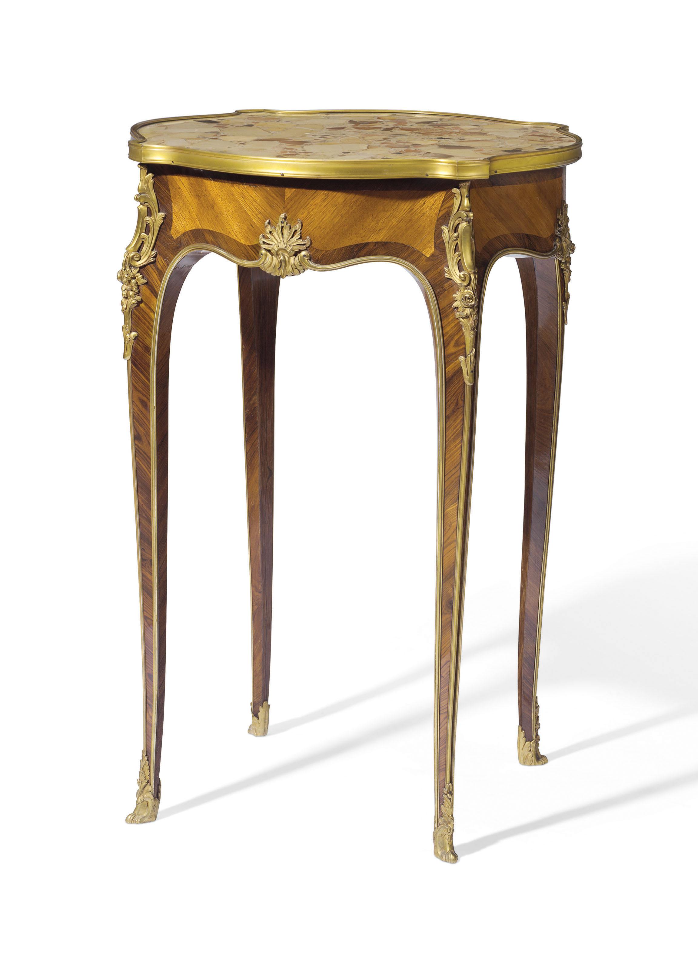 A French Ormolu Mounted Kingwood And Bois Satiné Gueridon Of Louis