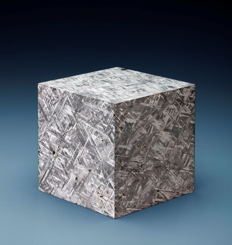 Large Muonionalusta Meteorite Cube — Crystalline Structure of an Iron Meteorite Dramatized in Three Dimensions, Iron, fine octahedrite Kiruna, Sweden. 116 x 116 x 116mm (4½ x 4½ x 4½in). Estimate $20,000-30,000. This lot is offered in Deep Impact Martian, Lunar and Other Rare Meteorites, 7-14 February 2018, Online