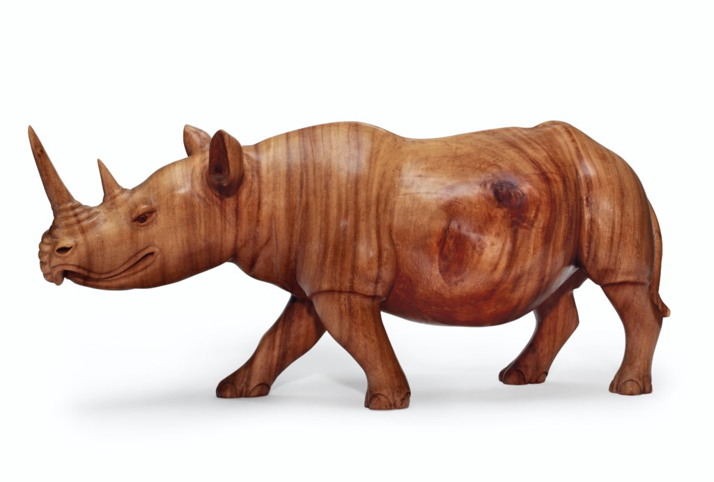A SOUTHEAST ASIAN LARGE CARVED WOOD MODEL OF A RHINOCEROS