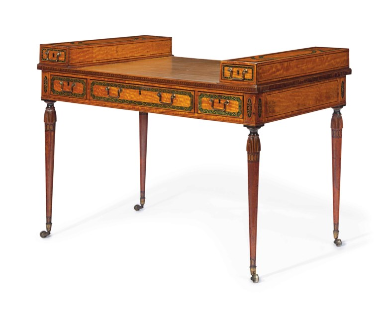 A late George III polychrome-painted satinwood double-sided writing table, circa 1790-1800. 34  in (86  cm) high, 48  in (122  cm) wide, 27  in (69  cm) deep. Estimate $8,000-12,000. This lot is offered in The Collection of David and Peggy Rockefeller English & European Furniture, Ceramics & Decorations, Part I on 9 May at Christie's in New York
