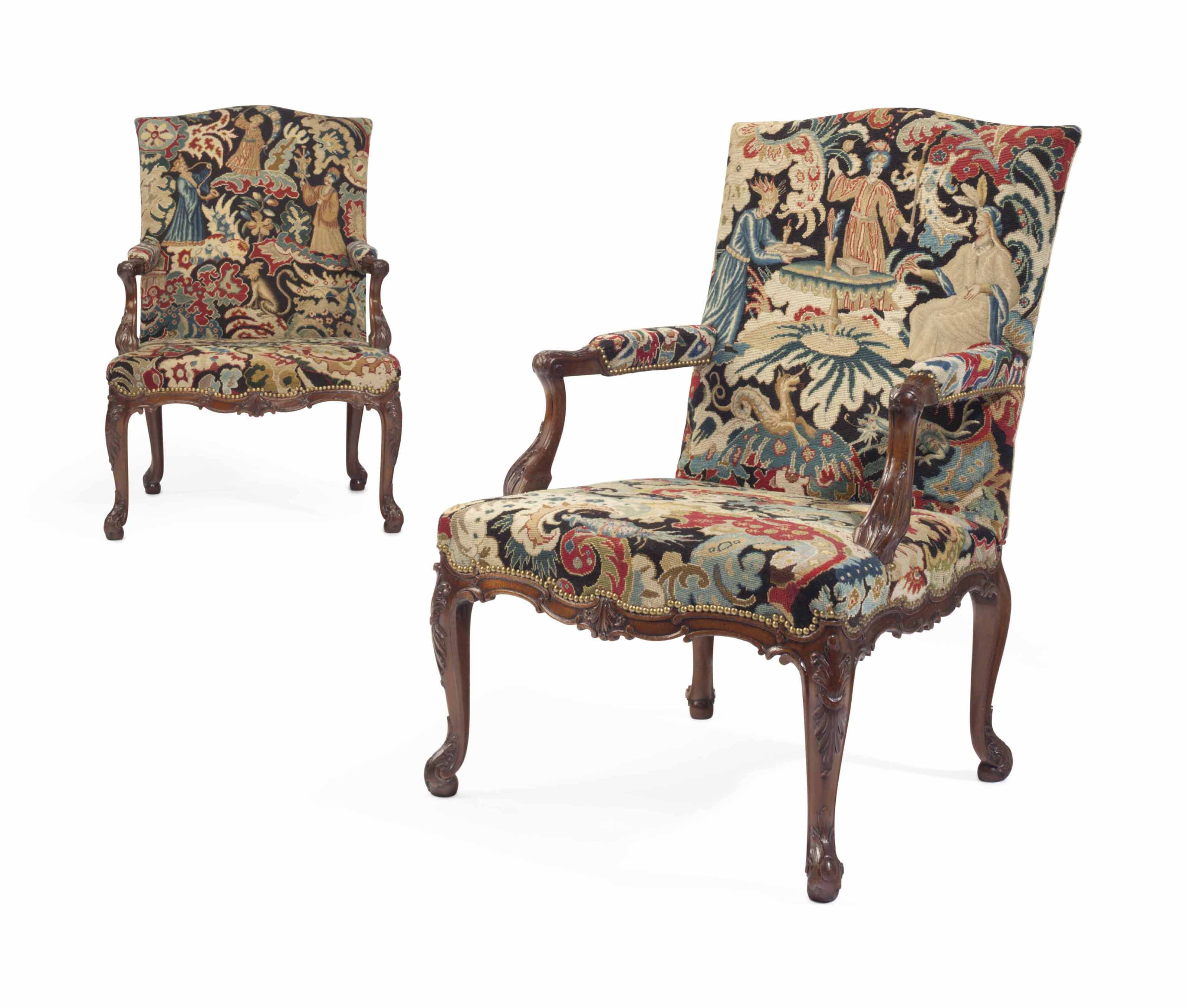 A PAIR OF GEORGE II SOLID MAHOGANY LIBRARY ARMCHAIRS
