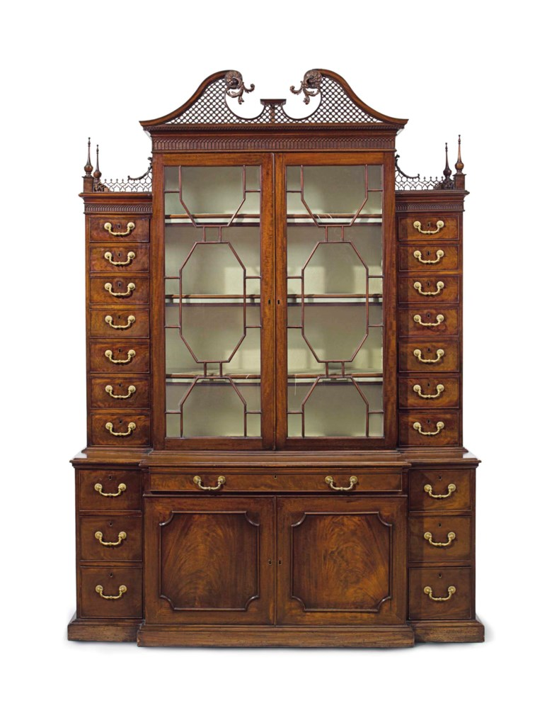 A George III mahogany breakfront secretaire cabinet, Possibly by Wright and Elwick, after designs by Thomas Chippendale, circa 1765. 95  in (241  cm) high, 68½  in (174  cm) wide, 21½  in (55  cm) deep. Estimate $50,000-80,000. This lot is offered in The Collection of David and Peggy Rockefeller English & European Furniture, Ceramics & Decorations, Part II on 10 May at