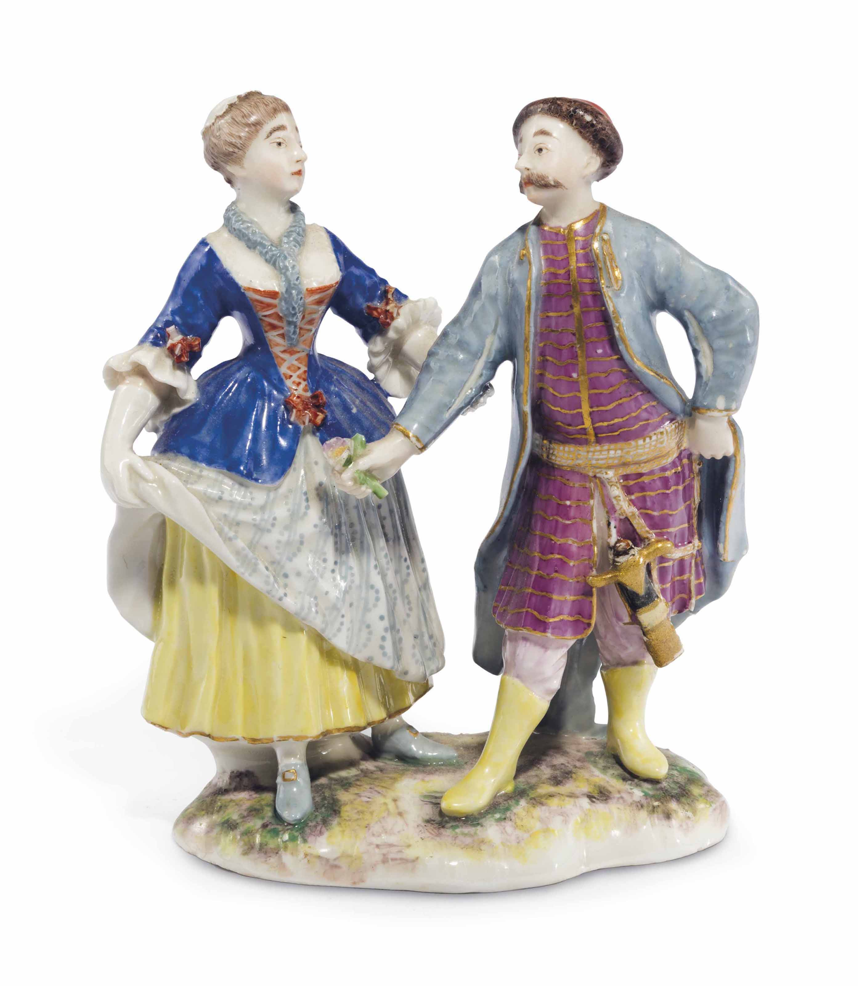 A LUDWIGSBURG PORCELAIN GROUP OF A TURK AND COMPANION